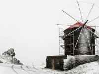 The snow covered windmill on the road towards Panormos and Pyrgos villages in Tinos